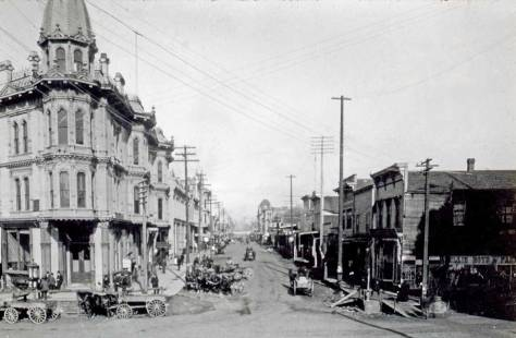 Looking north across Mill Street (Yesler Way) from the frame box that once housed Kellog's drug store on the main floor and, for a few months, the Sammis photography studio upstairs. [Courtesy, Lawton Gowey]