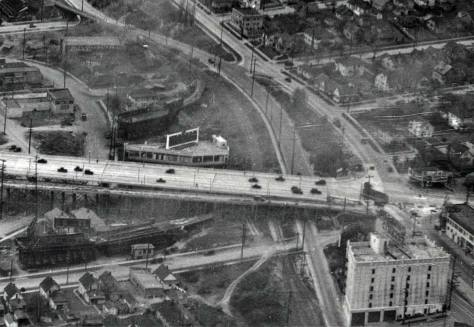 A detail from the April 1933 aerial showing the north end of the newly widened and supported bridge with the future Applied Physics Laboratory at the bottom and part of the Van de Kamp windmill beside it, to the right. [Courtesy, MOHAI]
