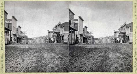 For comparison another - and somewhat later - look up Front through Cherry Street, this one by Peterson and Bros Studio, possibly the photographer also of our featured photo at the top.