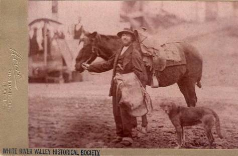 However soft the focus, given the street construction and the Seattle photographer Moore, this is Dutch Ned again in Seattle posing with his horse and now also his dog. (Courtesy, White River Historical Society.)