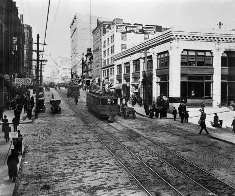 My old caption for this reads north through Columbia on Second, late in 1907. This dating has something to do with the near-completion of the ghostly Empire Building at the southeast corner of Second and Madison. The bank on the right, at the northeast corner of Second and Columbia, survives. Last I saw of it - long ago- it was an exercise gym.