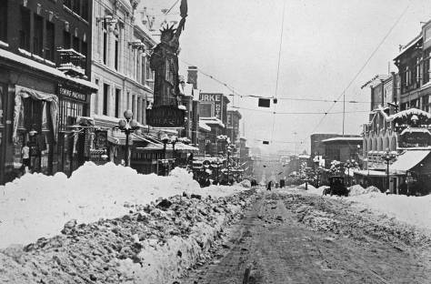 First Avenue south of Pine Street at the first melting of the Big Snow of 1916. The Liberty Theatre is on the left, and the Corner Market Building on the far right. (Courtesy, University of Washington Libraries, Northwest Collection in the Special Collections.