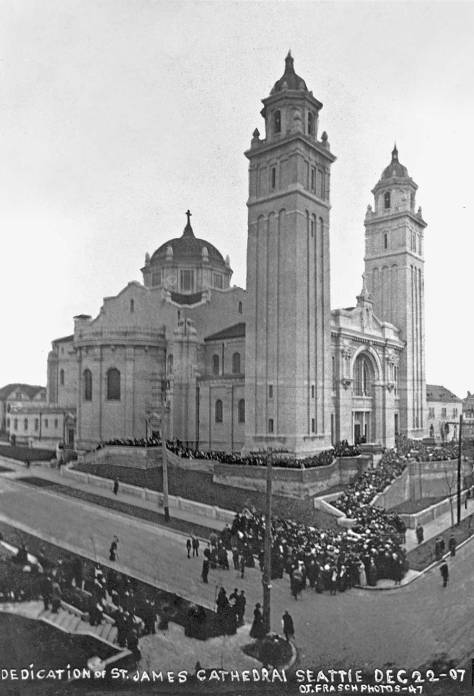 Saint James 1907 dedication, looking southeast thru the intersection of 9th Avenue and Marion Street.