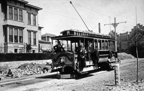 "With the power house on the right and the Haller mansion ""Castlemount"" on the left, a James Street Cable car approaches the end of its short run up First Hill from Pioneer Square."