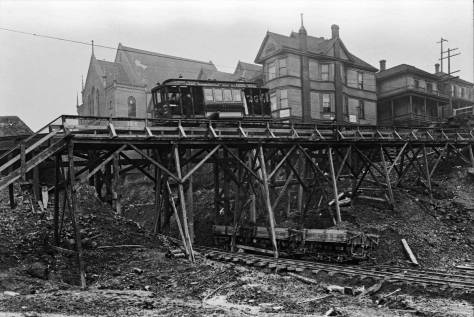 Extreme circumstances on the James Street Cable during the Fourth Avenue Regrade in 1907. The First Baptist church seen above the car did not survive the grade change, but moved to it's present corner on First Hill.
