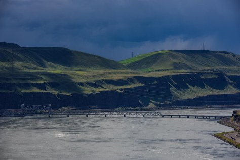The railroad bridge near Wishram threatened by looming dark clouds