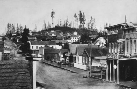 Looking north on Front Street (First Avenue) from the front second floor window of the Peterson & Bros Studio at the foot of Cherry street. The date is 1878 and the hill on the horizon is Denny, although its principal owner, Arthur Denny called it Capitol Hilll in hopes of luring the state capitol from Olympia to this his hill.