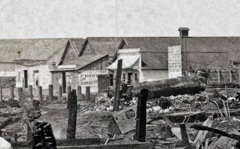 A detail from the featured photo showing the surviving warehouses at the end of Yesler's dock (or wharf). [Courtesy, Ron Edge]
