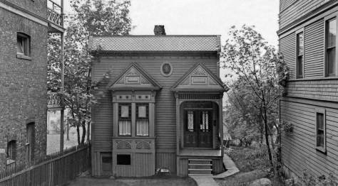 THEN: A carpenter's jewel with Victorian ornaments recorded by a tax assessor's photographer in 1936, nestles at 615 Eastlake beside the surviving Jensen Apartments, aka the O'Donnell Building, on the left. (Courtesy Stan Unger)