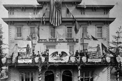 The bedecked Arlington Hotel at the southeast corner of Main St. and Commercial St. during the Villard visit of 1883.