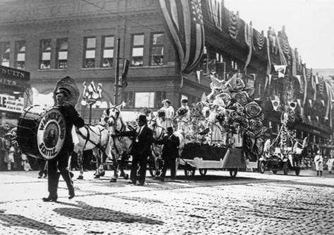 z-Potlatch-Parade-flower-float-Madison-2nd-w-Drummer-Wagner's-band-web