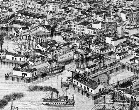 Part of Ballast Island is exposed, bottom-right, in this pre-fire 1884 Seattle Birdseye. Note Mill Street at the center. Here off-shore it is part of Yesler Wharf
