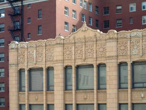 The White Garage's ornamental banding across Third Avenue from the garage on its east side. (2003)