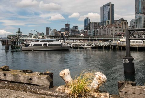 NOW: For his repeat, about 125 years late, Jean Sherrard looks north from what is left of the old Pier 48 to the King County Water Taxi's loading dock at the waterfront foot of Yesler Way.