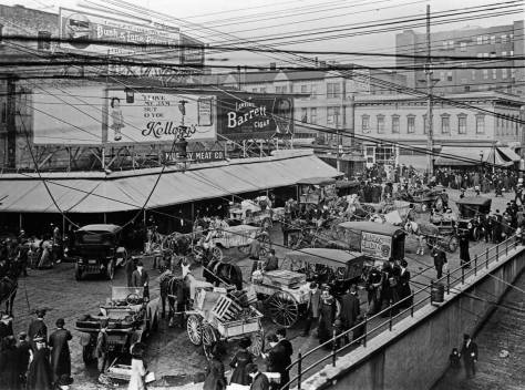 An early look down upon both Pike Place and the Post Alley (bottom-right corner) where they originate or conclude with First Avenue.