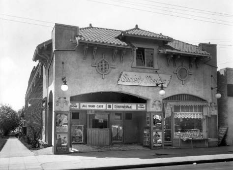 """THEN: Capitol Hill's Society Theatre first opened its doors in 1911. This record of it most likely dates from 1920, the first year in which the theatre could have shown the four films promoted with sensational posters near its front doors: the comedy """"Mary's Ankle,"""" """"The Sagebrusher,"""" a western, """"Silk Husbands and Calico Wives,"""" and """"Everywoman,"""" a feminist allegory appropriately filmed in 1919, on the eve of women's suffrage in the United States. (Courtesy Museum of History and Industry)"""