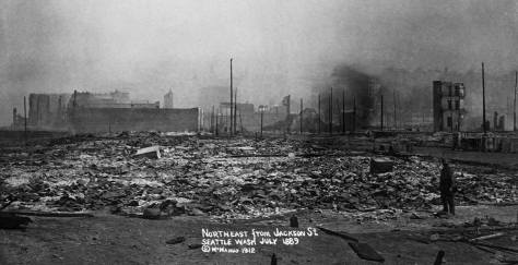 Great Fire (June 6, 1889) ruins looking north from Jackson street with Commercial Street (First Ave. S.) on the right. A McManus marketed this and several other photos of the ruins in July, 1889. By then much of the rubble was cleared away, the ruins razed, and the rebuilding begun.