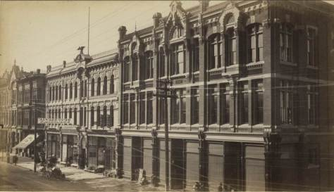 The Jeweler Nichols' shop was shaded by the awning on the far left at 109 Front Street and so closer to the Foot of Cherry Street than Columbia, which is at the knees of the photographer.