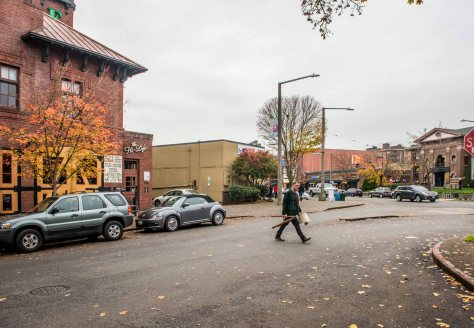 NOW: In addition to his photo of the 1911 Ballard Fire Station No. 18, Jean Sherrard has widened his repeat to include Ballard's Carnegie Public Library (1904) across NW Market Street.