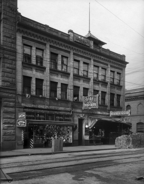 THEN: Built in 1900 the Corgiat Building lost its cornice and identifying sign to the 1949 earthquake. (Courtesy, Museum of History and Industry)