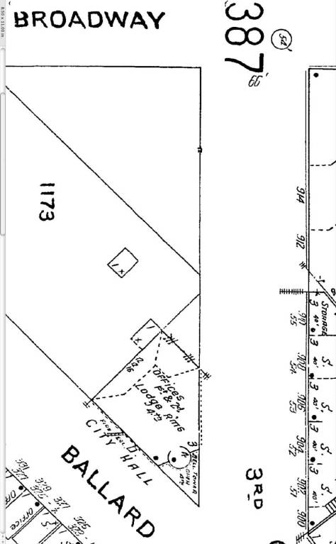 A detail from the 1904 Sanborn map of Ballard before its 1907 annexation into Seattle. Here the future 22nd Ave. N.W. is still numbered Third Avenue. The City Hall footprint holds the pointed corner.