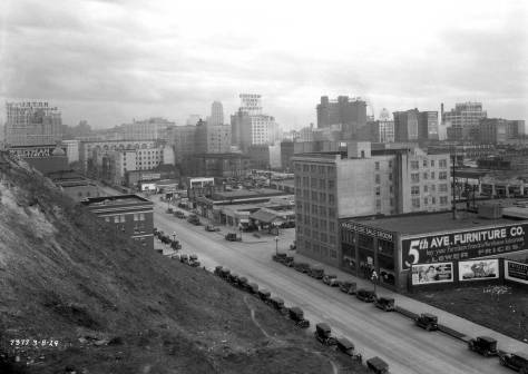 Looking south to the Central Business District from the cliff left in 1911 when the regrading stopped at Fifth Avenue. This public works shot is date March 8, 1929. Battery Street is behind the city photographer.