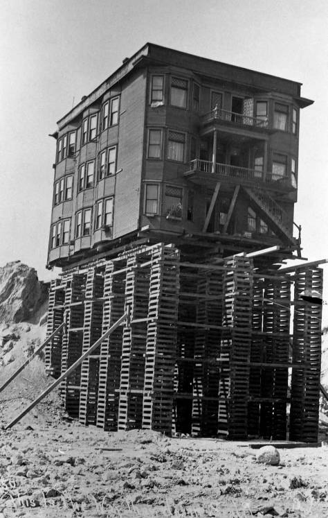 The Blanchard Apartments appear to be occupied during their lowering to the north side of Blanchard Street, between Second and Third Avenues.