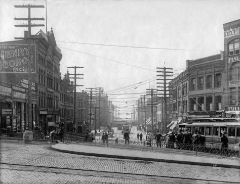 Looking south on Second Avenue S. over Yesler Way and the Fortson Square park and trolley stop. The Phoenix Hotel can be found on the left.