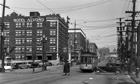 THEN: This 1939 glimpse east from Ninth Avenue follows Pike Street to the end of the about three-quarter mile straight climb it makes on its run from the Pike Place Market to its first turn on Capitol Hill.