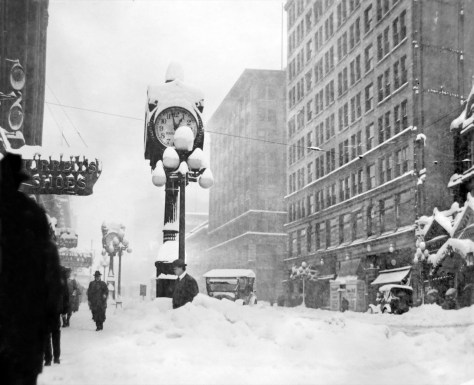 THEN: The Big Snow of 1916 trims two jewelers' clocks on the west side of Second Avenue, north of Marion Street. (Courtesy, Lawton Gowey)