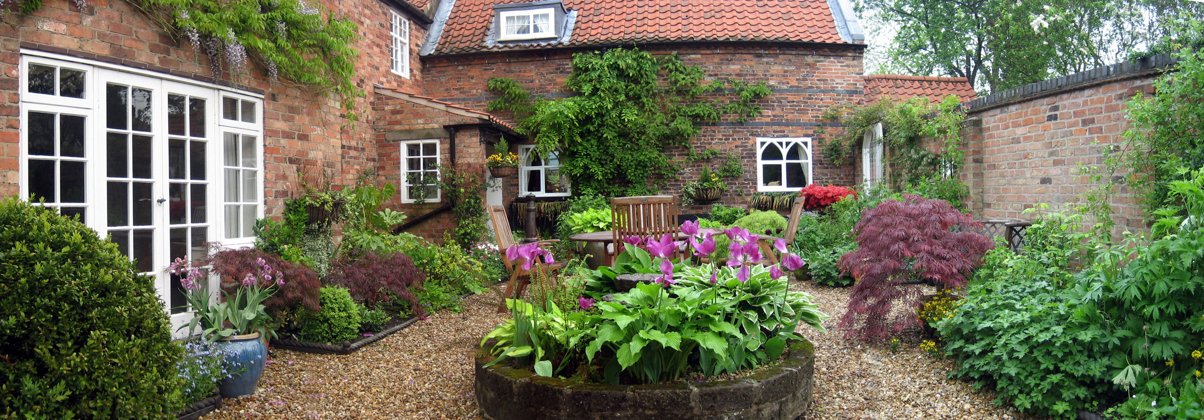 Traditional courtyard garden design style and planting ... on Courtyard Patio Ideas id=20635