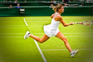 lady in white playing tennis