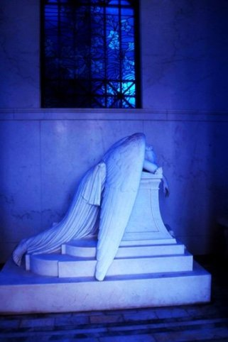 crying angel inside a crypt
