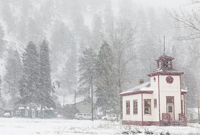 former one room school house in a snow storm