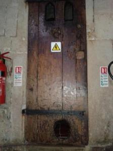 17thC cat hole  in the old clock door.