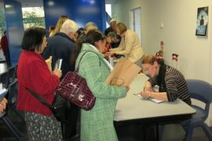 Selling and signing, albeit left-handed!
