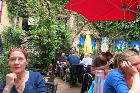 Relaxing in the vine filled courtyard at Les Compagnons dl la Grappe