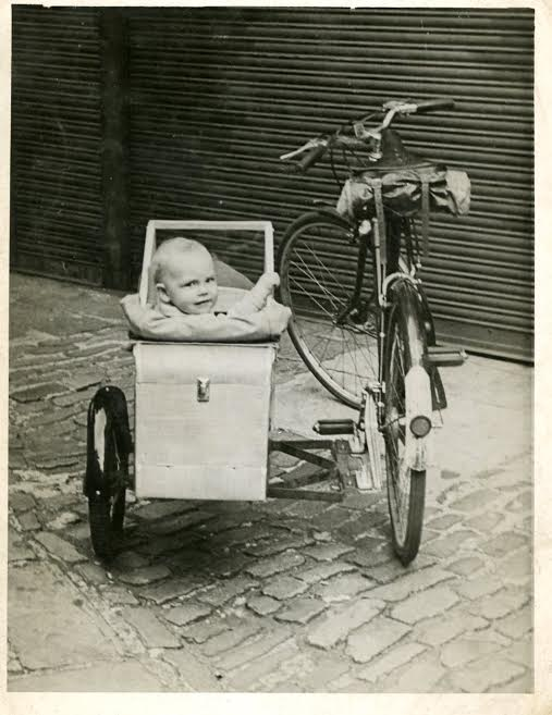 Baby Marica in her bicycle sidecar.