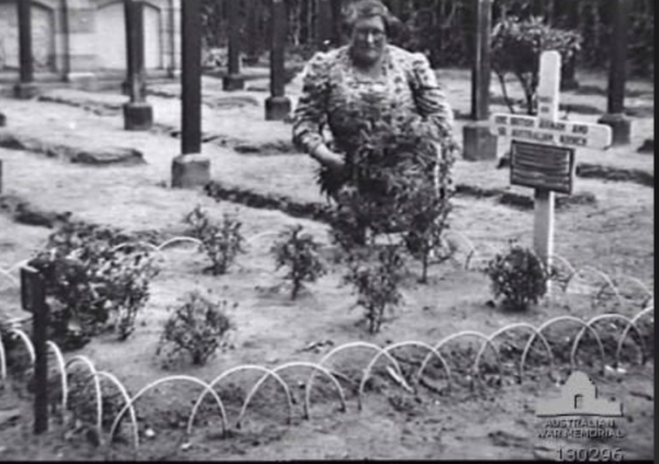 A local Dutch Woman tends the communal grave of the Lancaster crew.