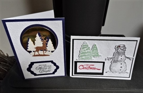 Two lovely, hand made Christmas cards.