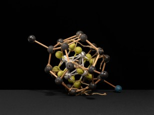 "A ""tinker toy"" molecular structure with rope. The rope was, perhaps, used to hang the model for display. Alternatively, it may have been used to demonstrate properties of bond valence. Ca. 1950s."