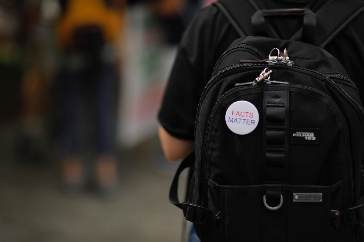 Facts Matter pin on a backpack