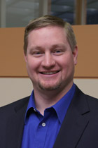 Frank Sain's headshot before he was erased from the company's website