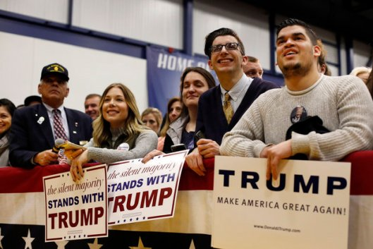 Supporters listen to a speech by Republican presidential candidate Donald Trump at a rally at the Great Bay Community College, Thursday, Feb. 4, 2016, in Portsmouth, N.H. (AP Photo/Robert F. Bukaty)