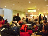 T3 waiting area - the blob of suitcases by AC students