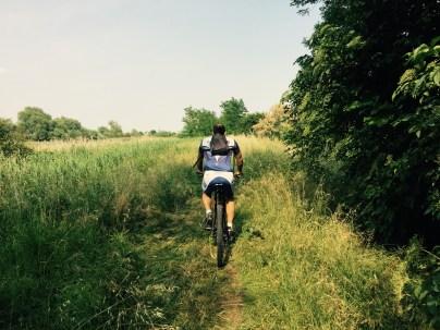 Bruno leads the grass path skirting Laguna Di Venezia