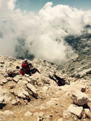 Mountaineer sleeping on the summit, Triglav