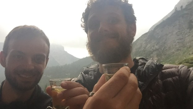 Nils Raabe and Paul Ferguson, toast with schnapps, Vodnikov Dom, Triglavski National Park