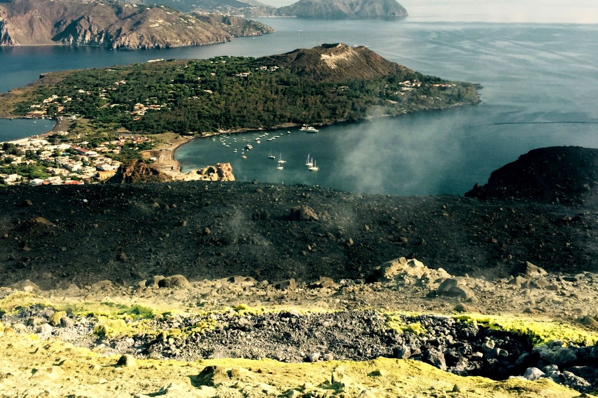 Sulpher vents and boats in the harbour, Vulcano, Sicily