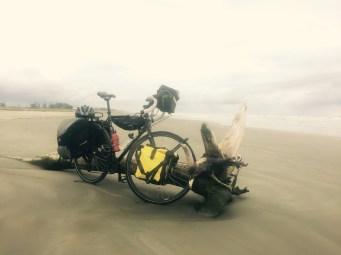 Touring bike on beach, Ilha Comprida, Brazil